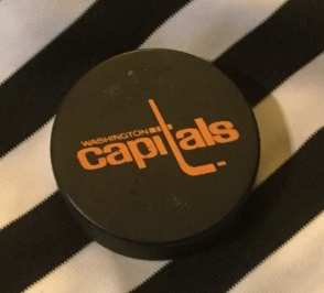 hockey puck and stripes